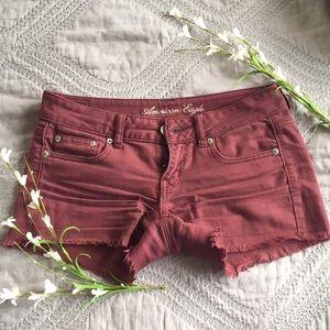 American Eagle frayed maroon jean shorts